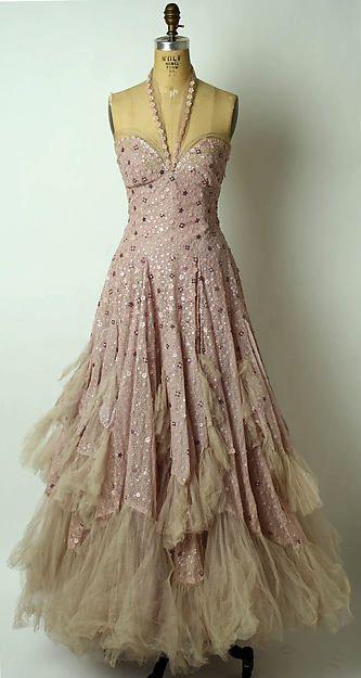 Ensemble Designer: Norman Hartnell Date: ca. 1943 Culture: British Medium: silk Accession Number: 1981.302a, b