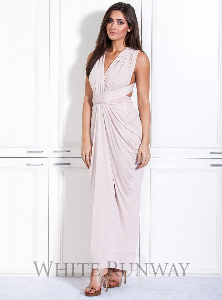 Nicolangela Goddess Gown. **Dresses are custom made to order so no returns are accepted on this style. Please contact us if you would like to arrange a sample order.**   A beautifully draped multi-way dress by Nicolangela. Made of a beautiful poly, spandex blend knit that can be styled over 8 different ways.