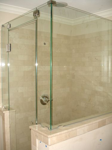 Renovation #1 - master bathroom with frameless glass shower and marble subway tile