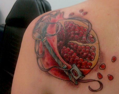 FYEAHTATTOOS:  I'm both a graphic designer and afeminist—I wanted my first tattoo to be political, but not some cliche, recognizable symbol. I first got the idea for the pomegranate while doing research on the history of birth control and abortion.In ancient times, pomegranates were used by women as a semi-effective birth control (it contains many hormones similar to The Pill) along with other herbs and plants. The fruit Eve ate? Until medieval times, it was a pomegranate. The pomegranate…