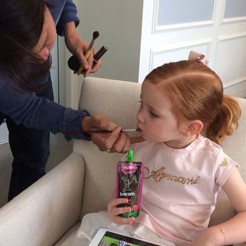 """Pixie Curtis gets her """"makeup"""" done (i.e. lip balm applied) on a shoot. #makeup #pixiecurtis #beauty #parenting"""