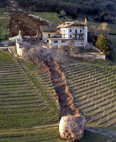 Giant boulders plough through Italian farm - in pictures | A landslide in northern Italy caused several boulders to roll down a hillside in Ronchi di Termeno, destroying a barn, barely missing a farmhouse and leaving a trail of destruction through vineyards