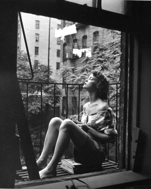 Nina Leen, A young woman napping on her balcony, New York City, 1950s. (Source: legrandcirque, via knifeladder)