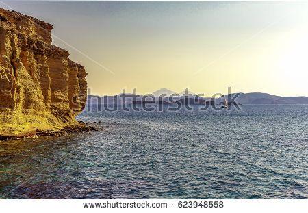Scenic  Greek Aegean Sea landscape with a sailboat in the horizon