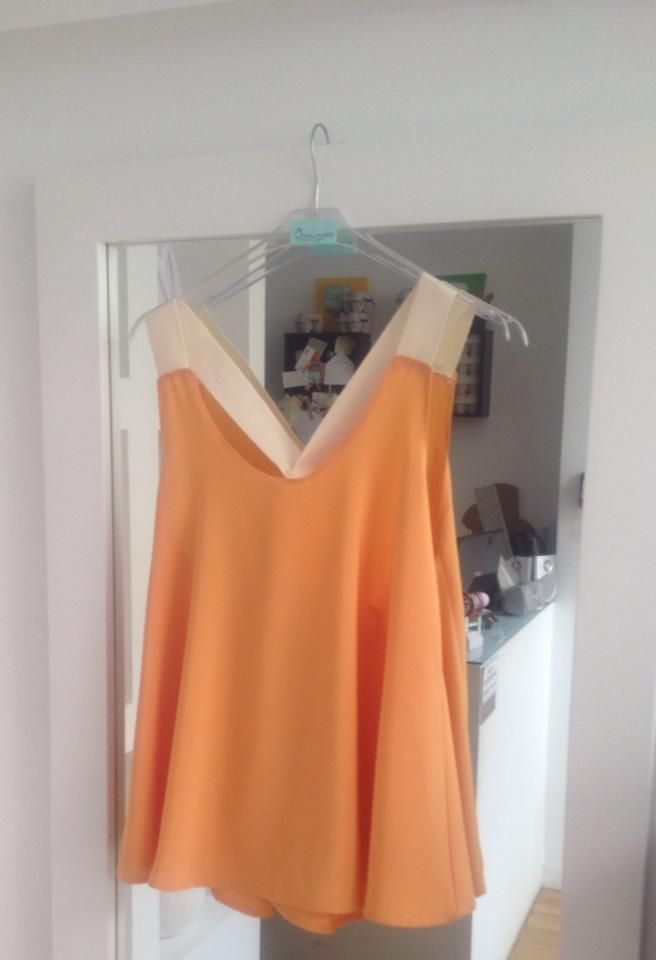 Gorgeous color for tanned ladies - cross back loose fit top