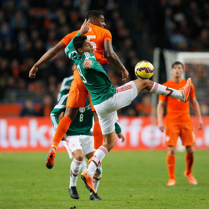 Leroy Fer of Netherlands and Raul Jimenez of Mexico battle for the ball during the international friendly match between Netherlands and Mexico held at the Amsterdam ArenA on November 12, 2014 in Amsterdam, Netherlands.