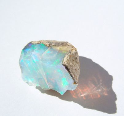I love opals! They have such a dream-like quality when not overpowered by excessive gold settings.   They remind me of where the sea laps the shore, and of the refracted light as the waves break onto the sand.