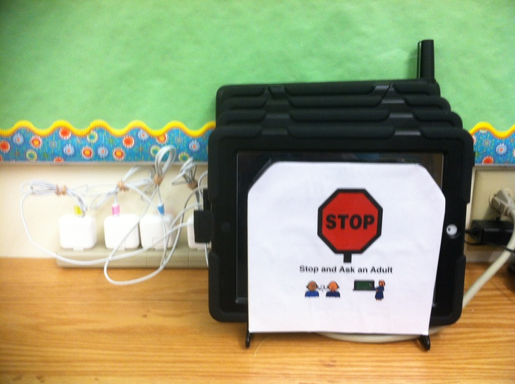 DIY Classroom iPad Storage & Charging Station.  Use a desk file holder and you can you can use charging cords labeled each end with highlighter tape in case they get tangled.  I added the stop sign as a visual for my Special Education students that an adult must get the pads for them.