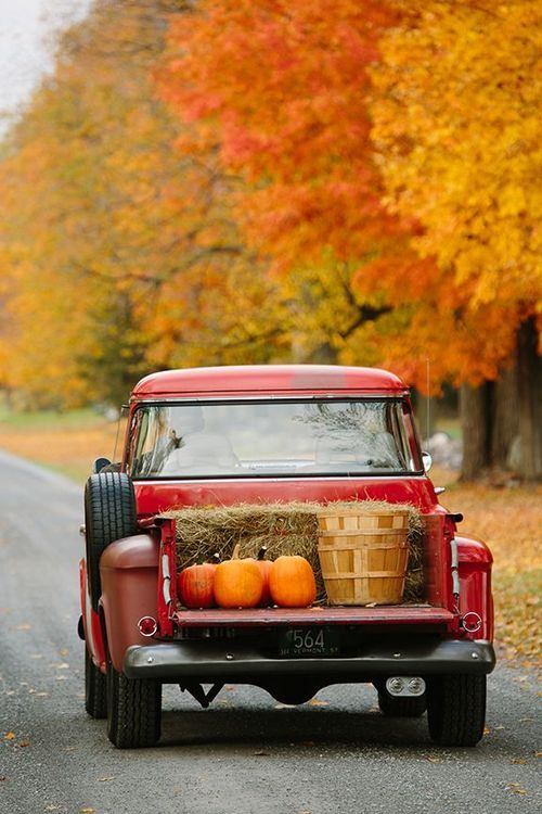 Nothing is more American than an old pickup driving down a country road filled with pumpkins, apples and straw.