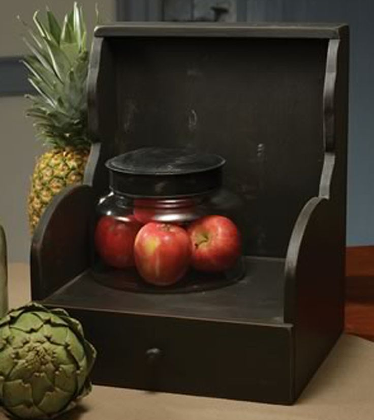 Black finish cabinet can help keep books, photo albums and the like organized while only taking 1' of space!