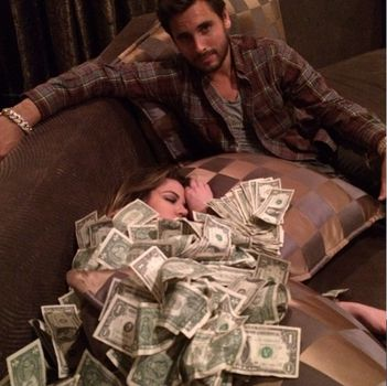Scott Disick posts pictures of Khloe covered in money