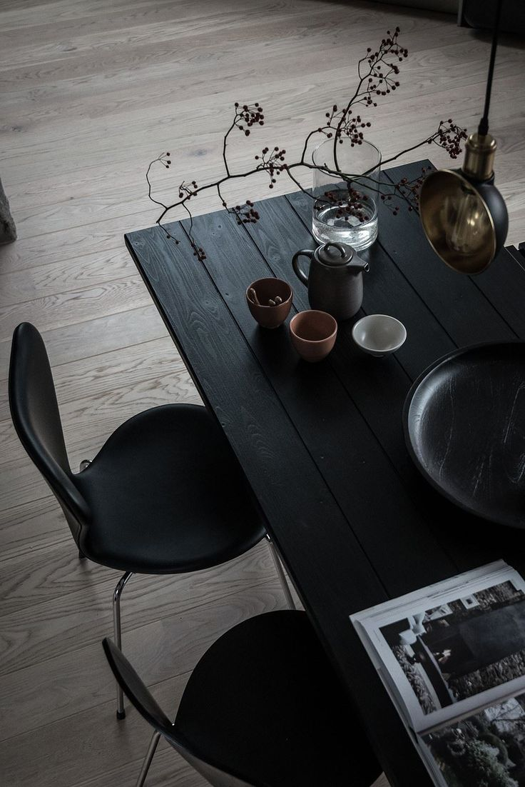 Beautiful black wooden plank dining table and black dining chairs