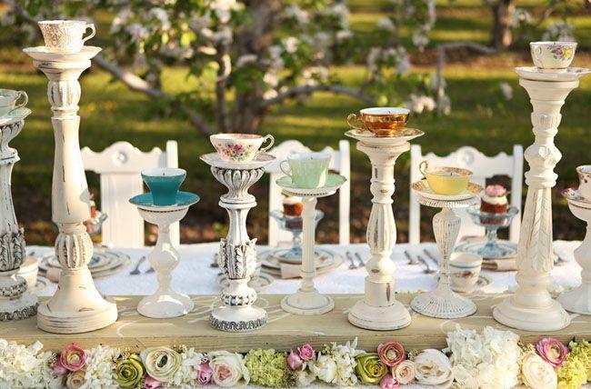 tea cups on candlesticks centerpieces