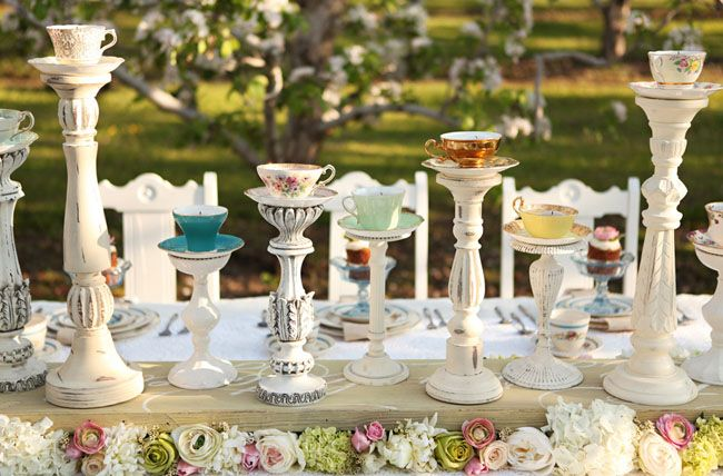 tea cups on candlesticks centerpieces