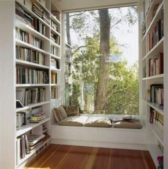 Love the bright window seat and small and cozy great for coffee, tunes or reading.  Great bookcases and I could fill them very quick....