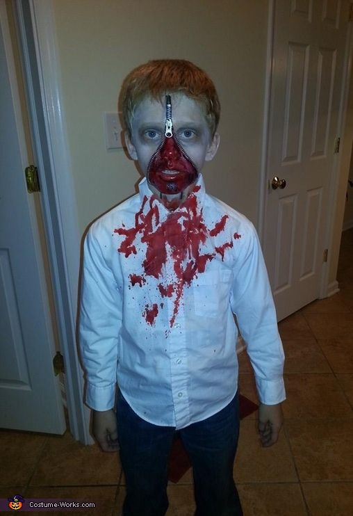 Taylor: This is my son Joshua dressed up as a walking zombie. We adhered a zipper to his face and applied red paint and fake blood to his face. With lots...