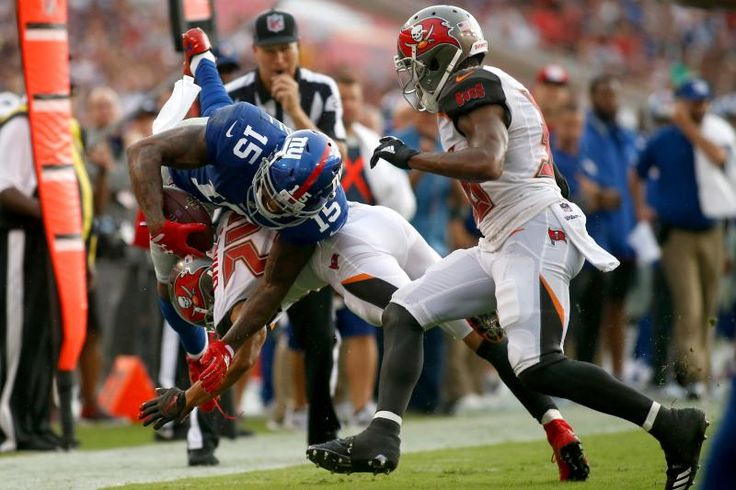 TAMPA, FL - OCTOBER 1:  Wide receiver Brandon Marshall #15 of the New York Giants is hit by cornerback Brent Grimes #24 of the Tampa Bay Buccaneers during a carry in the second quarter of an NFL football game on October 1, 2017 at Raymond James Stadium in