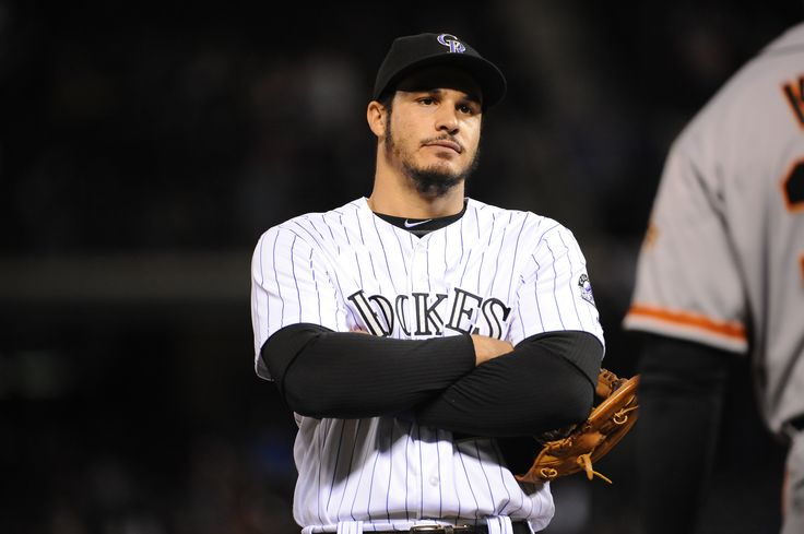 Nolan Arenado of the Colorado Rockies reacts to a play against the San Francisco Giants at Coors Field on May 27, 2016 in Denver, Colorado. The Rockies defeated the Giants 5-2