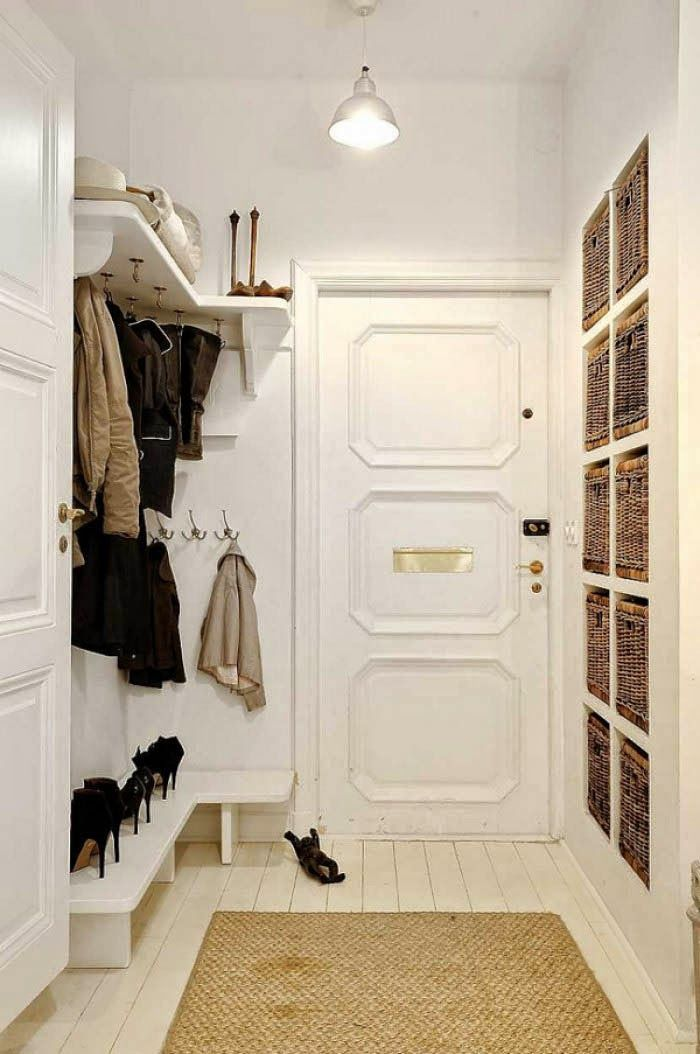 beautiful organized entry hallway with hooks shelves and shoe storage really like the built in baskets