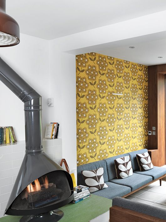 Orla Kiely living room with floral wallpaper and matching cushions. Seventies inspired. More decorating ideas at http://www.redonline.co.uk