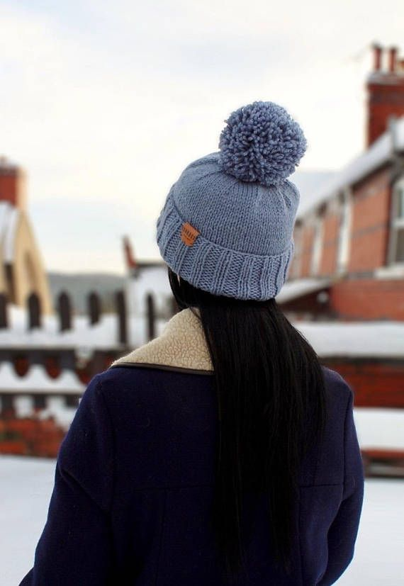 Unique one off handknitted bobble hat in cornflower blue. Each piece is knit by hand in our North Wales studio so every hat is unique. Finished with a Junkbox Ultraleather tag. Wool/Acrylic blend. Unisex style. One size fits all. THE Winter accessory!!! (Co-ordinating items are