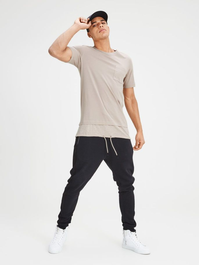 Longer length t-shirt, slim fit made from comfortable cotton with drawstrings at hem. Available in taupe, cream, beige, black and light grey   JACK & JONES