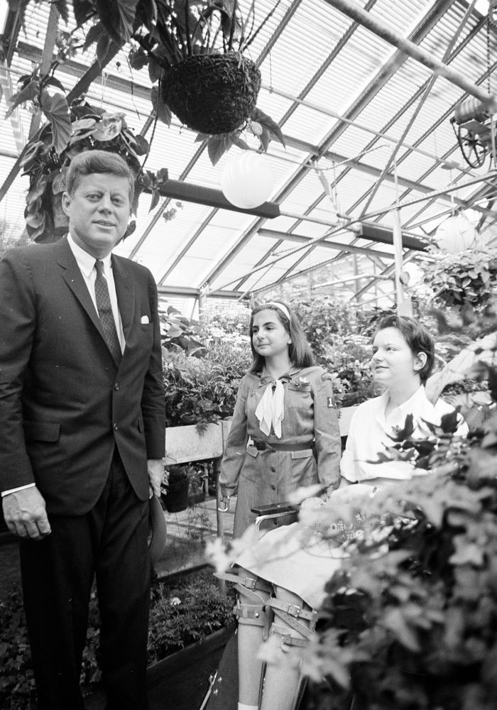 May 18, 1962: President John F. Kennedy visits with Patricia Corte (right), daughter of the late Charles Corte (photographer for United Press International) and the late Katherine Corte, during a visit to the Institute of Physical Medicine and Rehabilitation at the New York University Medical Center. An unidentified girl stands in center.