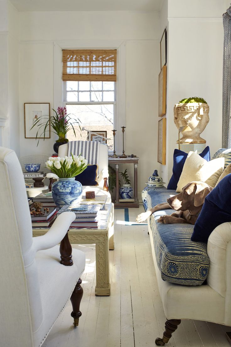 William_Mclure_Apartment love the batik sofa cushion and white painted floor | blue and white living room | white walls | Matchstick blinds | chinoiserie coffee table - really pretty!