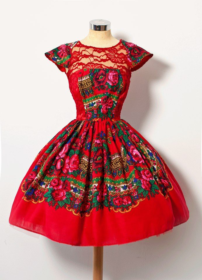 Gorgeous dress, beautifully shaped. A truly vivid Polish RED - LOVE the floral and the elegant sheer lace neckline.