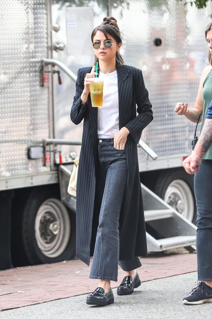 Selena Gomez wearing Kate Young For Tura Pearl Sunglasses in Silver, Tod's Black Leather Moccasins, Sandy Liang Tinder Cropped Flared Jeans and Coach Selena Grace Bag