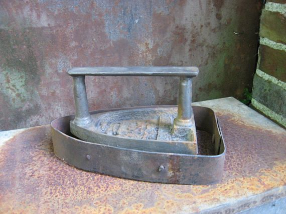 French Flat Iron & Base, 1800s antique sad   hand iron 'Le Parisien' with metal blacksmith made rustic trivet. Sold   together or seperately @ PumpjackPiddlewick