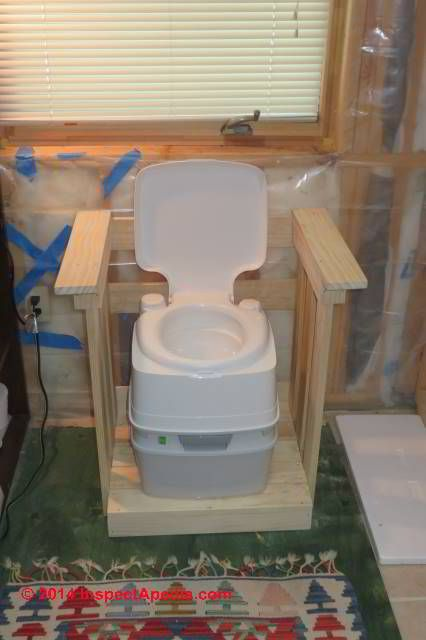 Wood platform provides handicapped accessible height and railings for a chemical toilet - The Throne (C) Daniel Friedman Jennifer Church