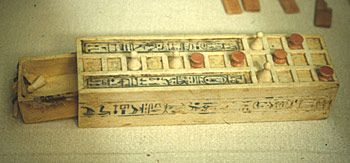 Tutankhamun's tomb contained a number of gaming boards for the game of Senet. The rules of the game are not certain, but it was for two players, whose aim was to knock their opponent off the board. The number of squares moved was decided by throwing sticks (used like dice today). Clearly Tutankhamun was a keen player and this small version is a 'travelling set' made of painted ivory.