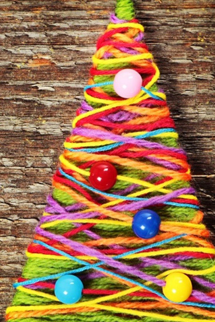 Bright and colourful little Christmas trees. Cut a traingle from thick card and wind colourful yarn threaded with wooden beads for a Christmas craft with more colour than the lights on the tree!