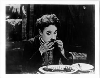 Chaplin Eating Boots