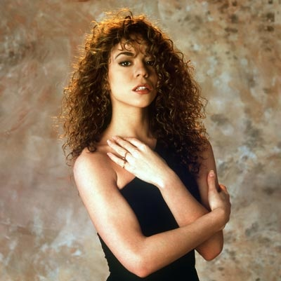 This picture of Mariah Carey from the early 90s is making us feel nostalgic! We love long, voluminous curls!