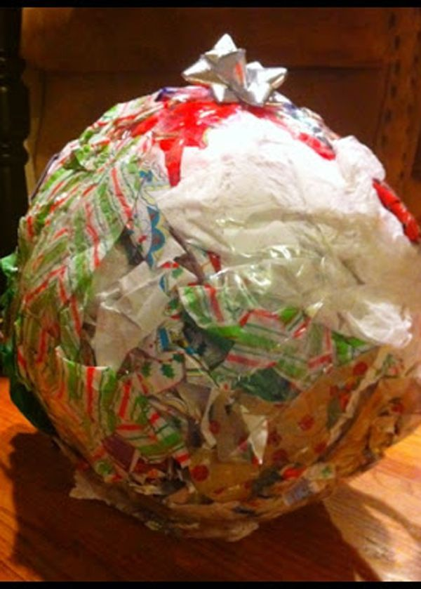 "Use old wrapping paper, packaging tape and plastic wrap to roll various treats and gifts into a giant ball. Guests take turns trying to unwrap the ball (the highest value ""prize"" should be in the center) while the person next to them rolls a pair of dice. Once the dice roller gets doubles, time is up and the ball must be passed to the next player. Get the instructions at Sparkly Polliwog. - WomansDay.com"