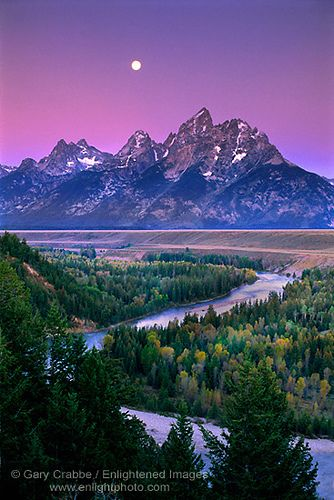 Full moon setting at dawn over the Teton Range and Snake River, Grand Teton National Park, Wyoming