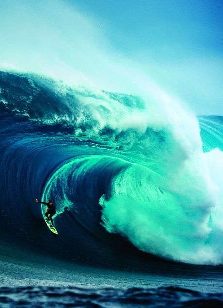 The color of the water and the trail made by the surf board looks intense!!!