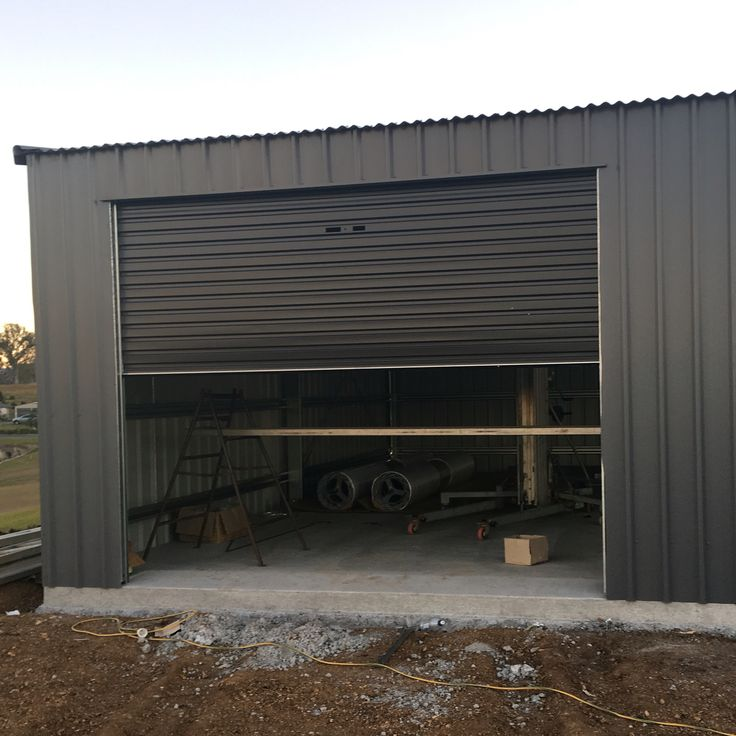 Basalt colorbond shed with monument roller doors