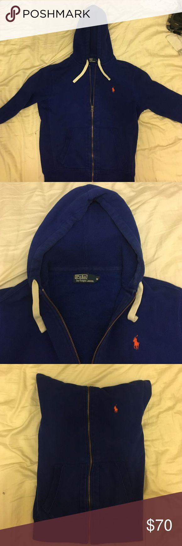 Blue Zip Up Hoodie Used Ralph Lauren blue zip up hoodie with orange symbol. Polo by Ralph Lauren Sweaters Zip Up