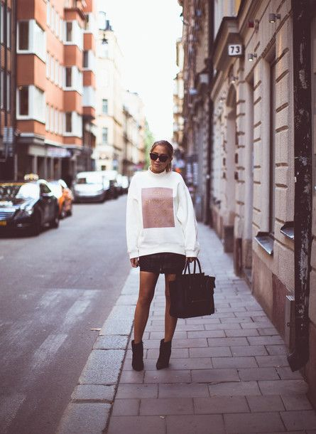 $133 Start to build your layering wardrobe with this oversized sweater from Acne, black mini skirt, stylish ankle boots and a large handbag.