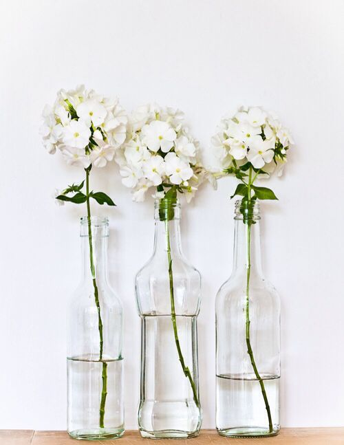 Simplicity - lovely vignette made out of 3 different glass bottles + 1 flower in each #home decor