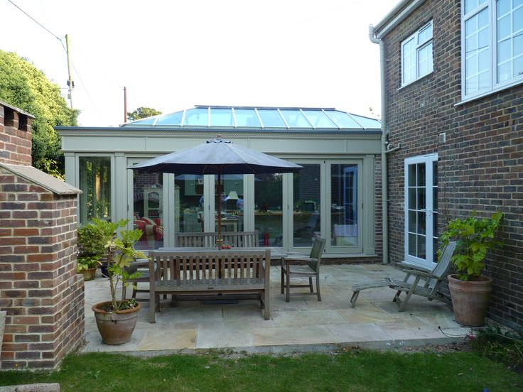 A full side of sliding bi fold doors for this clients kitchen orangery. Designed and Installed by Moore Inspiration