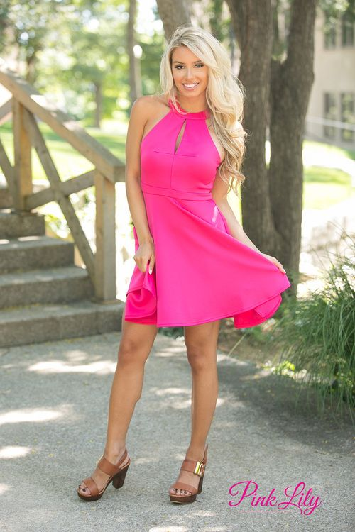 This bright hot pink dress is all you ever wanted in a dress! Featuring a trendy halter top, a keyhole cutout in front, and some gorgeous lace on the back panel, this dress has the best of summer trends all in one outfit! There's also a zipper on the back and an elastic waistband for extra ease and comfort.