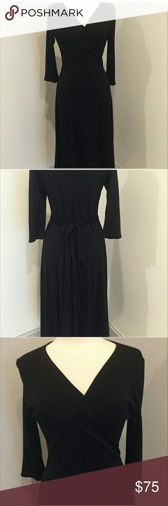 Eileen Fisher Wrap Dress Black wrap dress. Never worn by me. Too big. Beautiful light weight wool black wrap dress. Eileen Fisher Dresses Midi