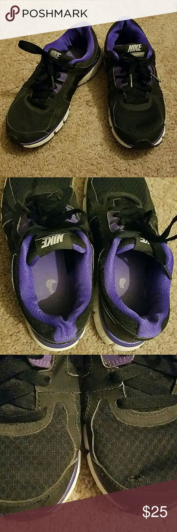 Nike Dual Fusion Sneakers Nike Dual Fusion Sneakers size 7, purple and black, gently used with minor signs of wear a d a tiny tear on one shoe seen in the 3rd pic! Please message me if you have any questions! Nike Shoes Sneakers