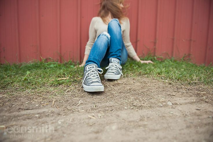 sitting on ground. wide angle of shoes