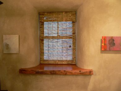 Urbana straw bale bathroom window- show how thick the windows are in earthship homes- terrific insulation