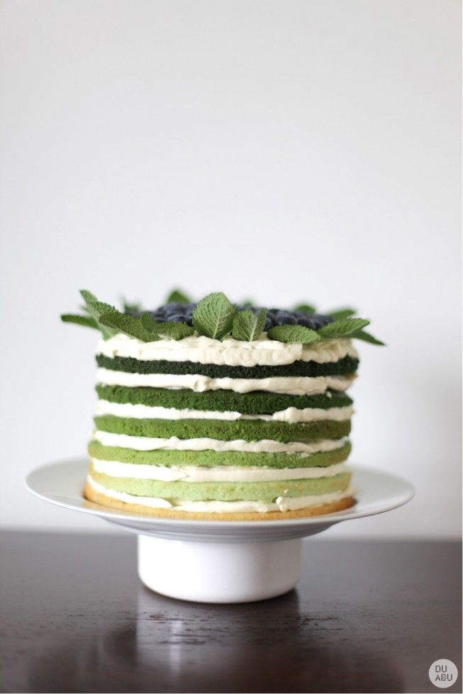 Green rainbow cake with mint, lime, double cream and blueberry and its